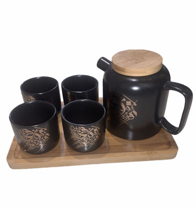 Picture of Teapot set with four cups and a wooden serving tray